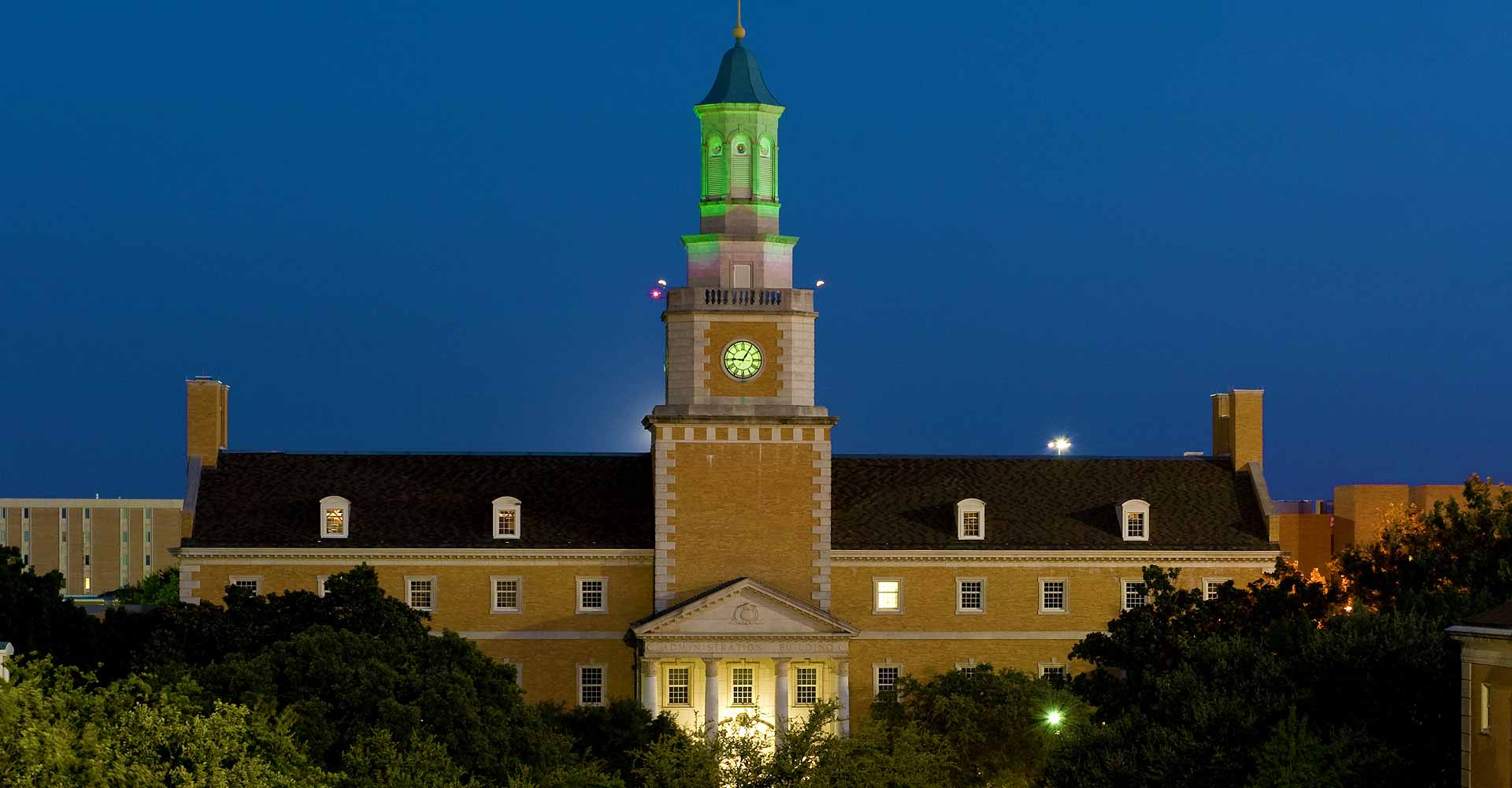 The UNT Administration Building's tower is lit green after Mean Green victories.